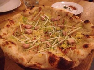 Cured foie gras, caramelized onions, and matchstick apple pizza.