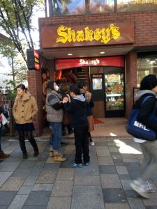 Okay, come on now.  When there's even a line outside Shakey's Pizza, then you know someone is screwing with you.