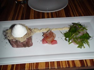 Lamb Terrine with pickled turnips, bread chips, herb salad, and horseradish foam.