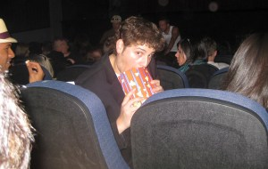 A candid shot of David Blue enjoying a little popcorn.