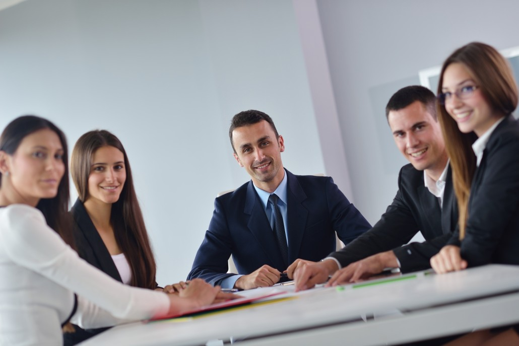A Business Meeting with People Smiling