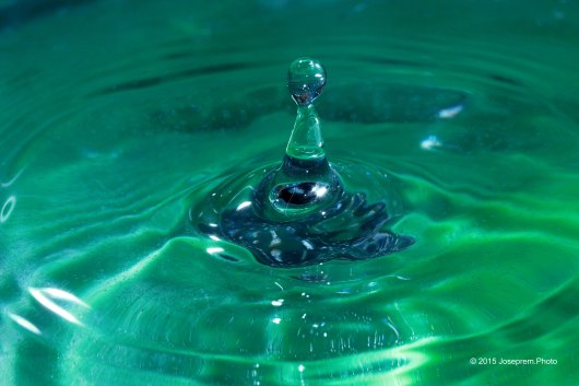 Classic green-man rises above the water surface.
