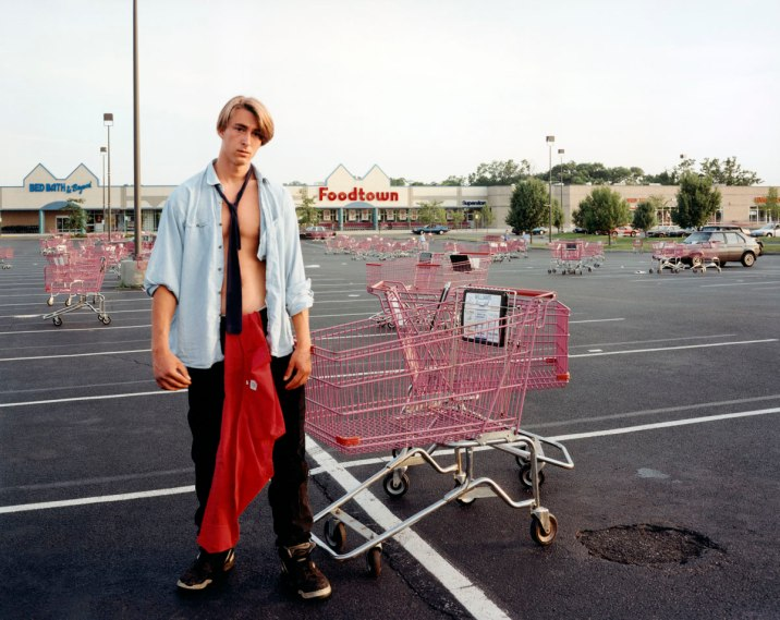 young-man-gathering-shopping-web