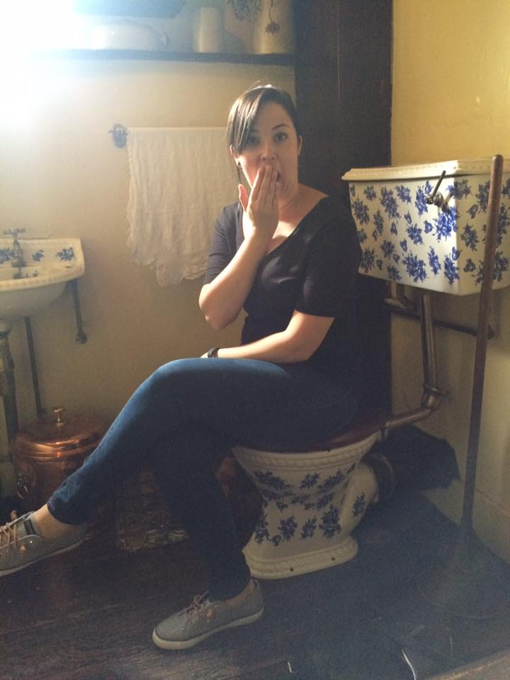 Lindsey, at the Sherlock Holmes museum, seated on her rightful throne.