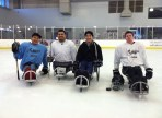 With the local ice sled hockey team