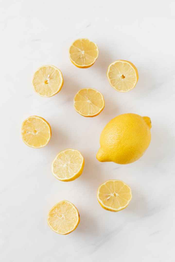 composition of fresh lemons on white surface