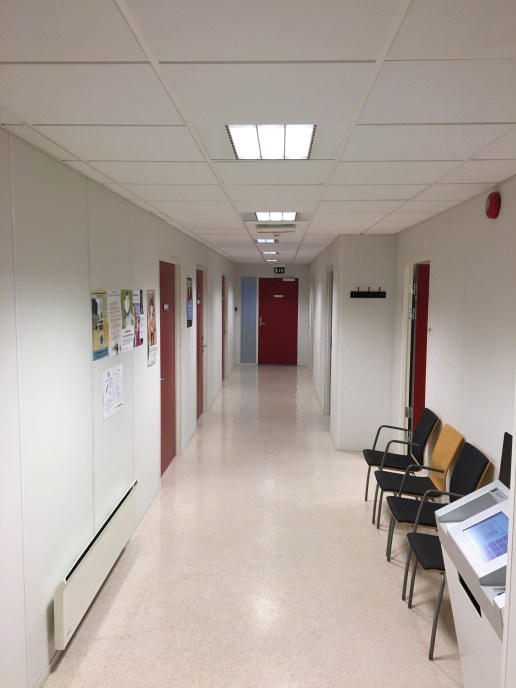 """A view down the hall of a GP clinic. Everything was incredibly clean and tidy.... bordering on """"sterile."""""""