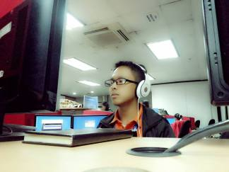 A photo of me working as a Quality Analyst. Photo was taken last Nov. 26, 2013