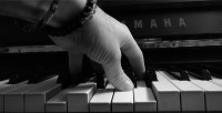spider hand on piano