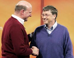 Bill Gates and Steve Ballmer shake hands on a job well done