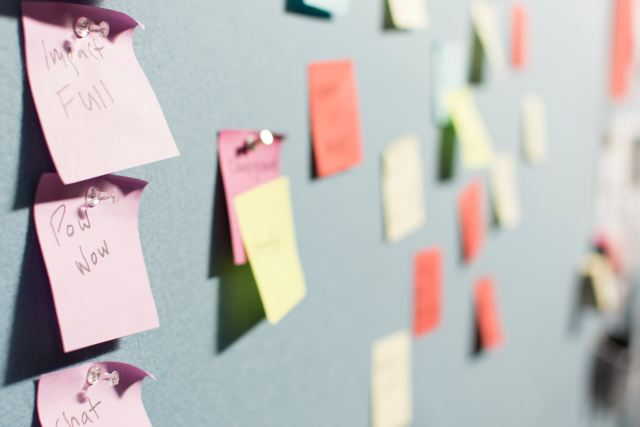 sticky post-it notes on a wall