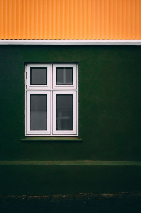 lone-window-green-wall-orange-roof