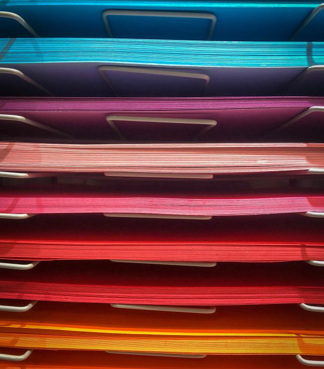 various-color-folders-stacked-atop-each-other