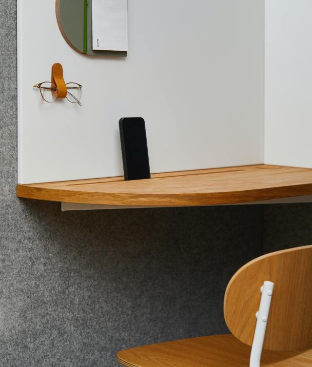corner table with phone and chair