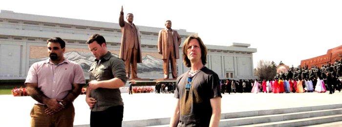 Joshua Spodek, Jordan, Joseph in front of Kim Il Sung and Kim Jong Il statues
