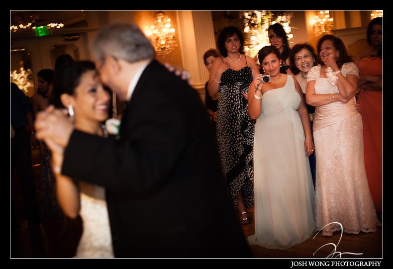A bridesmaid watches the father-daughter dance. Garden City Hotel, Garden City, NY