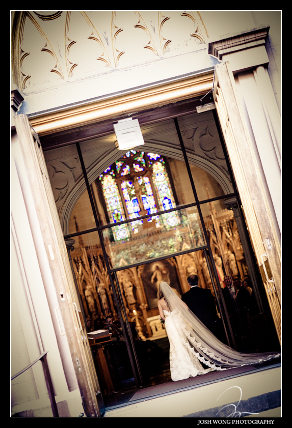 The bride entering escorted by her father. Old St. Patrick's Cathedral Wedding pictures provided by Josh Wong Photography