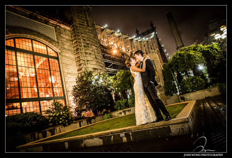 The magnificent nighttime wedding picture outside of Guastavino's with the bridge in the background. Wedding pictures by one of NYC's Top Wedding Photographers - Josh Wong Photography
