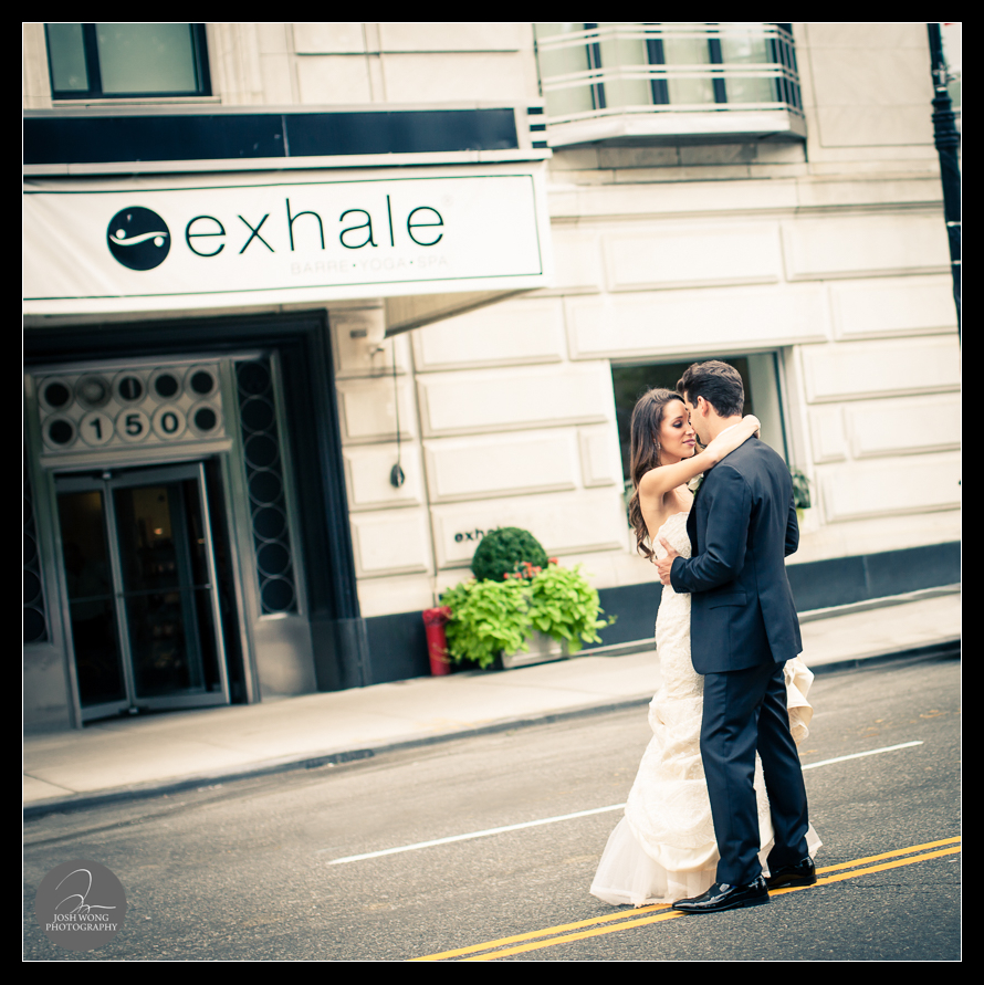 The bride and the groom share an intimate moment outside of the Essex House before heading to Central Park for bride and groom wedding portrait pictures.  JW Marriott Essex House Wedding. Wedding Pictures and photos provided by Josh Wong Photography, New York City