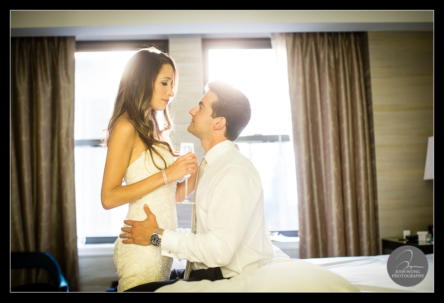 Moments after their ceremony, the couple head back up to their bridal suite to reflect and share a private moment together. JW Marriott Essex House wedding pictures and photos provided by Josh Wong Photography, NYC
