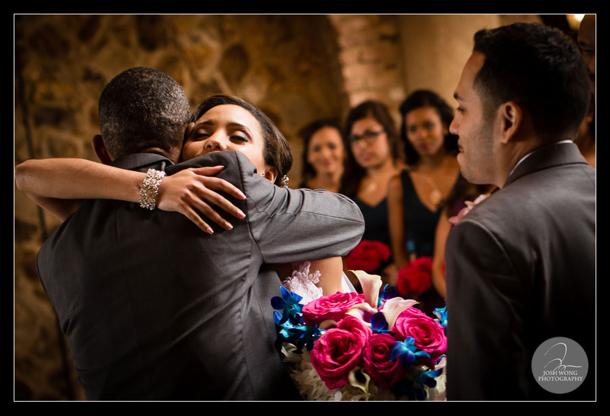Father daughter embrace at the wedding ceremony.