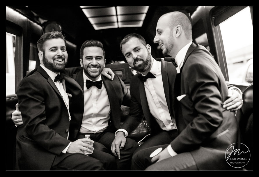 The groom and his groomsmen on the party bus en route to the ceremony, St. Vartan Cathedral.  New York Wedding pictures by Armenian wedding photographer Josh Wong Photography