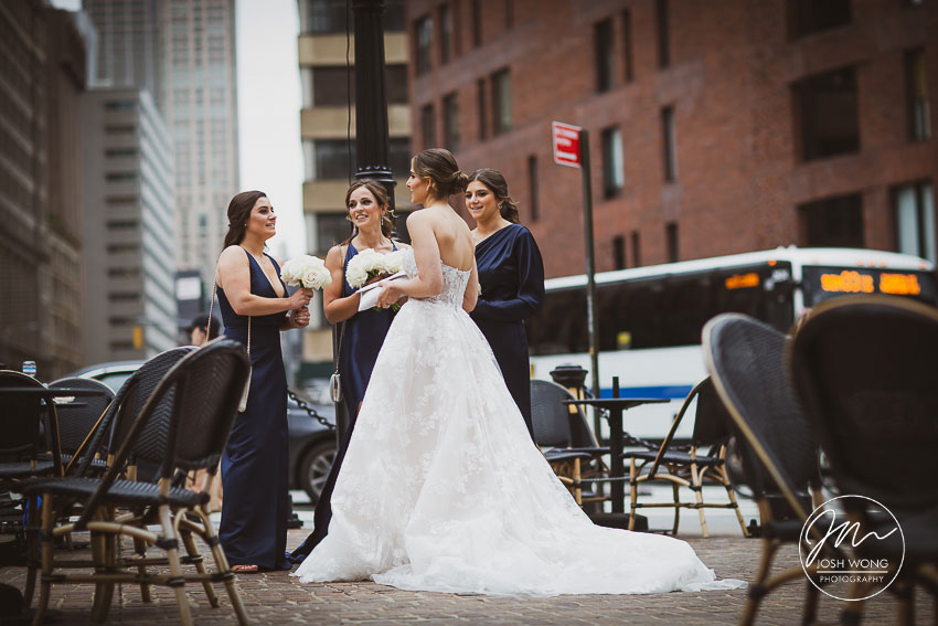 The bride and the bridesmaids wait just outside of the Roxy Hotel on their way to the ceremony site.