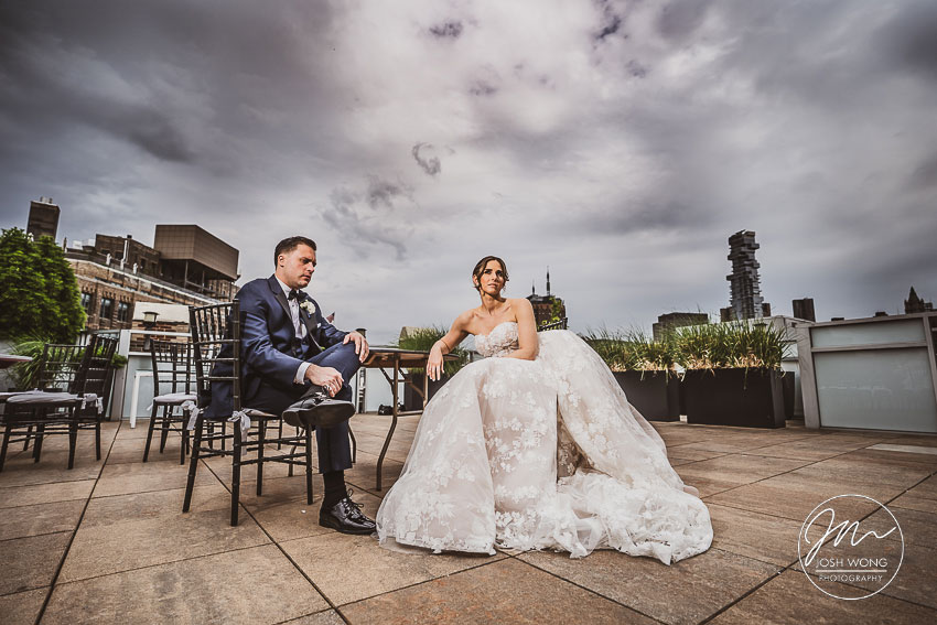 The bride and groom take a little breather on the rooftop of Tribeca Rooftop