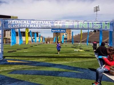 Terri finishing the Glass City Marathon!