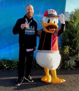 Josh Zeigler with Donald Duck after the Disney World Half Marathon