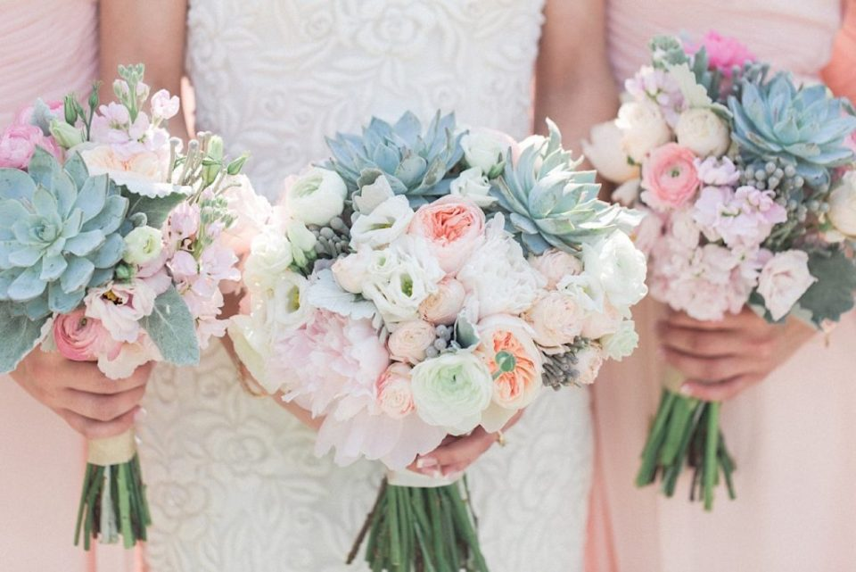 Bridesmaids with blush flowers and succulents by A Garden Party at a backyard wedding in New Jersey