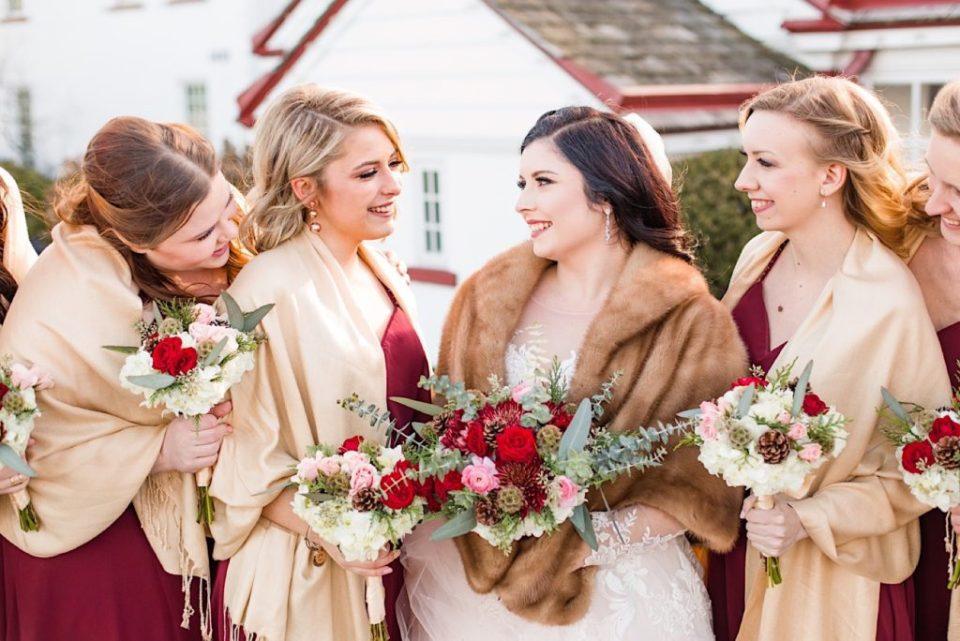 Bridesmaids with maroon and green bouquets by Willow and Thistle at Normandy Farm in Blue Bell