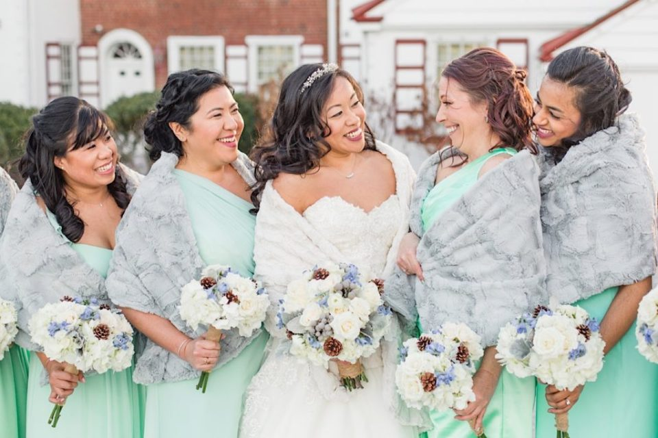 Bridesmaids with light blue and white bouquets by Willow and Thistle at Normandy Farms in Blue Bell