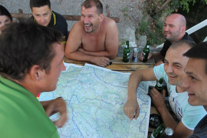 Route planning on map with friendly locals in Bosnia.