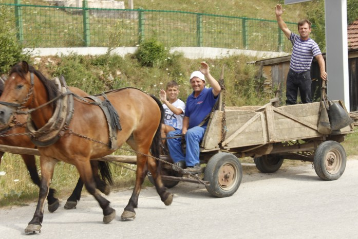 Friendly locals on horse and kart in Bosnia.