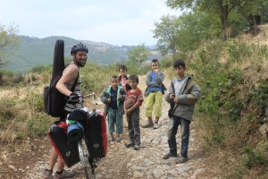 Meeting friendly locals on my bike touring adventure on the road less travelled in Albania.