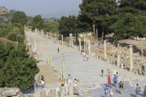 Ancient Ephesus tourists go to harbour.