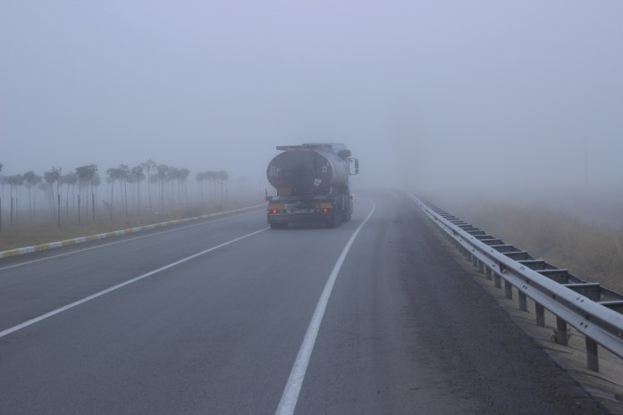 A foggy morning on the road.