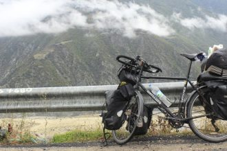 Touring bike in front of mountains.