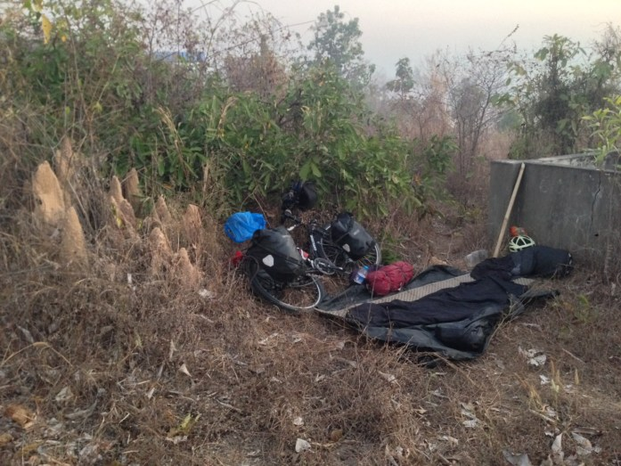 Illegal Wild Camping in Myanmar next to termite mound without a tent on my bike tour cycling around the world.