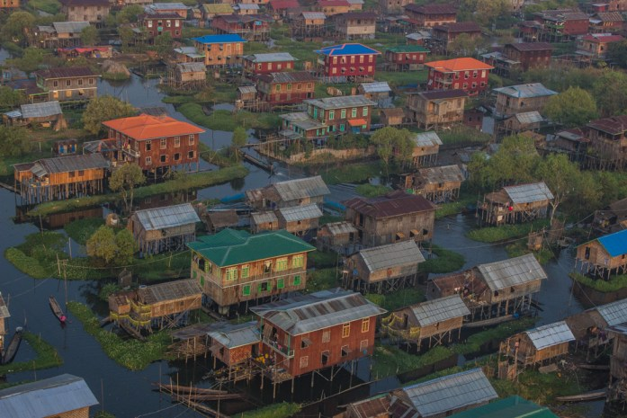 A floating village on stilts on Inle Lake in Myanmar from a hot air balloon.