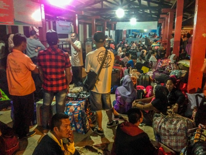 Crowds of people sleeping at Bintan Ferry Port waiting for Pelni ferry.