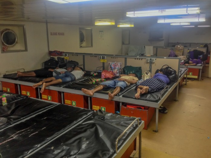 Many people sleeping on the economy class of a Pelni ferry in Indonesia.