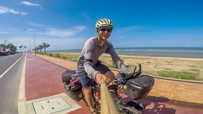 A selfie with selfie stick while cycling by the beach in Thailand East coast.