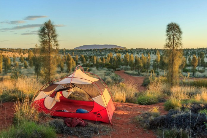 Camping in a tent in front of Uluru in the Australian Outback