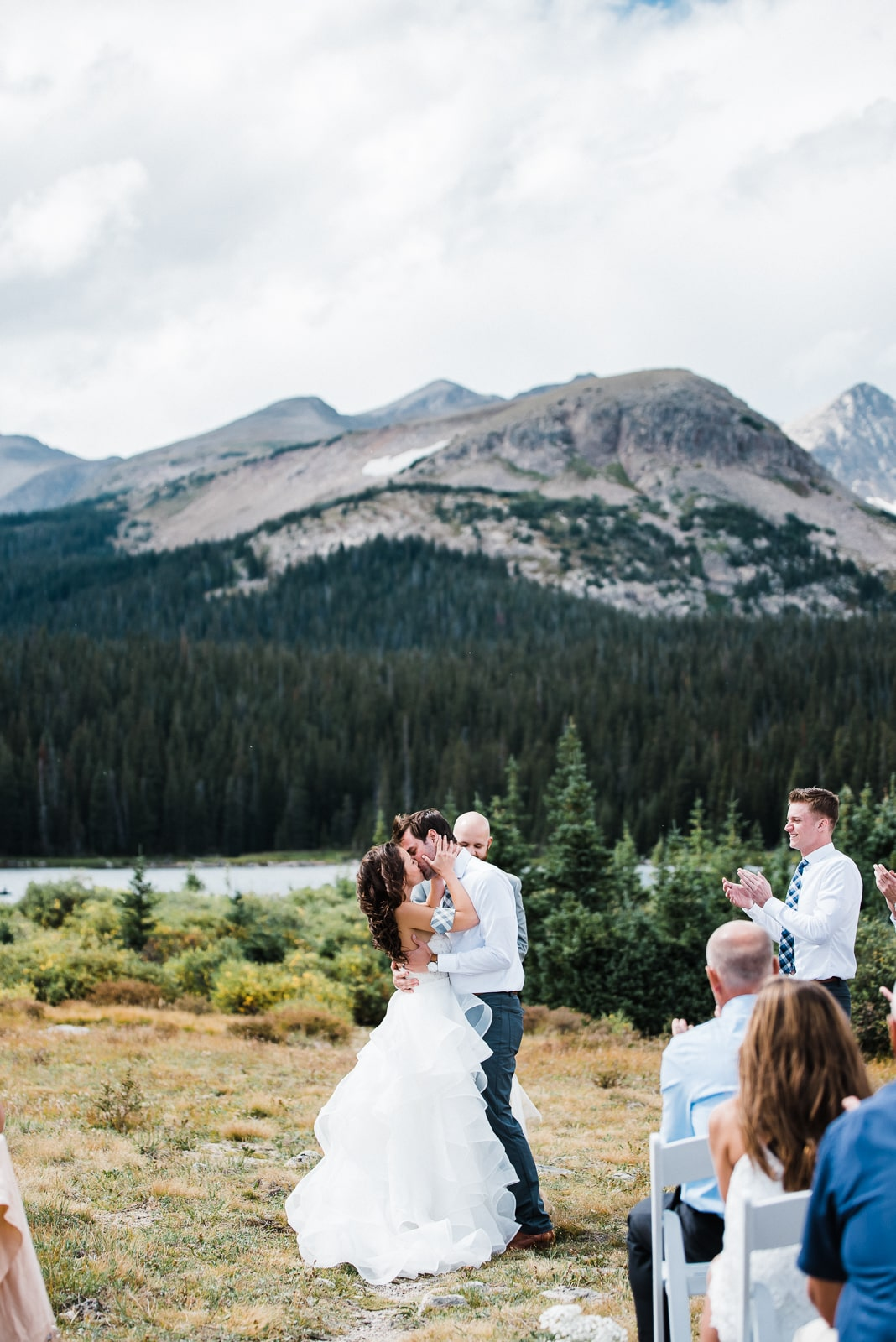 Couple has their first kiss at Brainard Lake in Colorado. Brainard Lake is one of the best locations for engagement, elopement and wedding photos near Denver. DIY Autumn Colorado Wedding | Brainard Lake Wedding | Josie V Photography