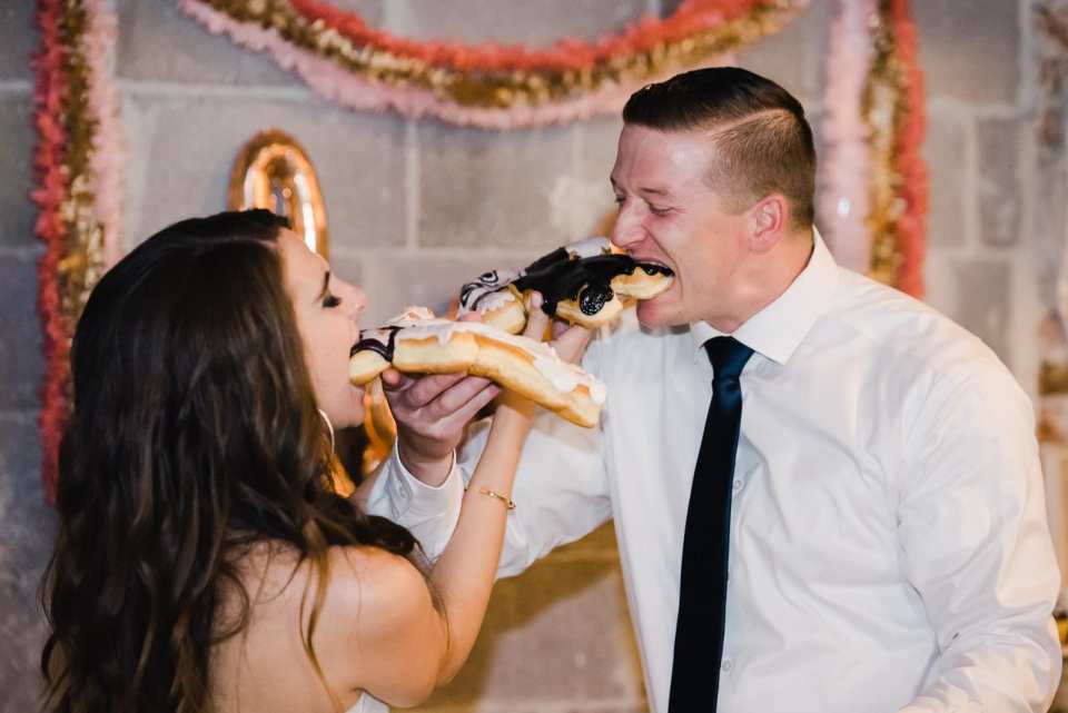 Whimsical doughnut cake cutting by Josie V Photography