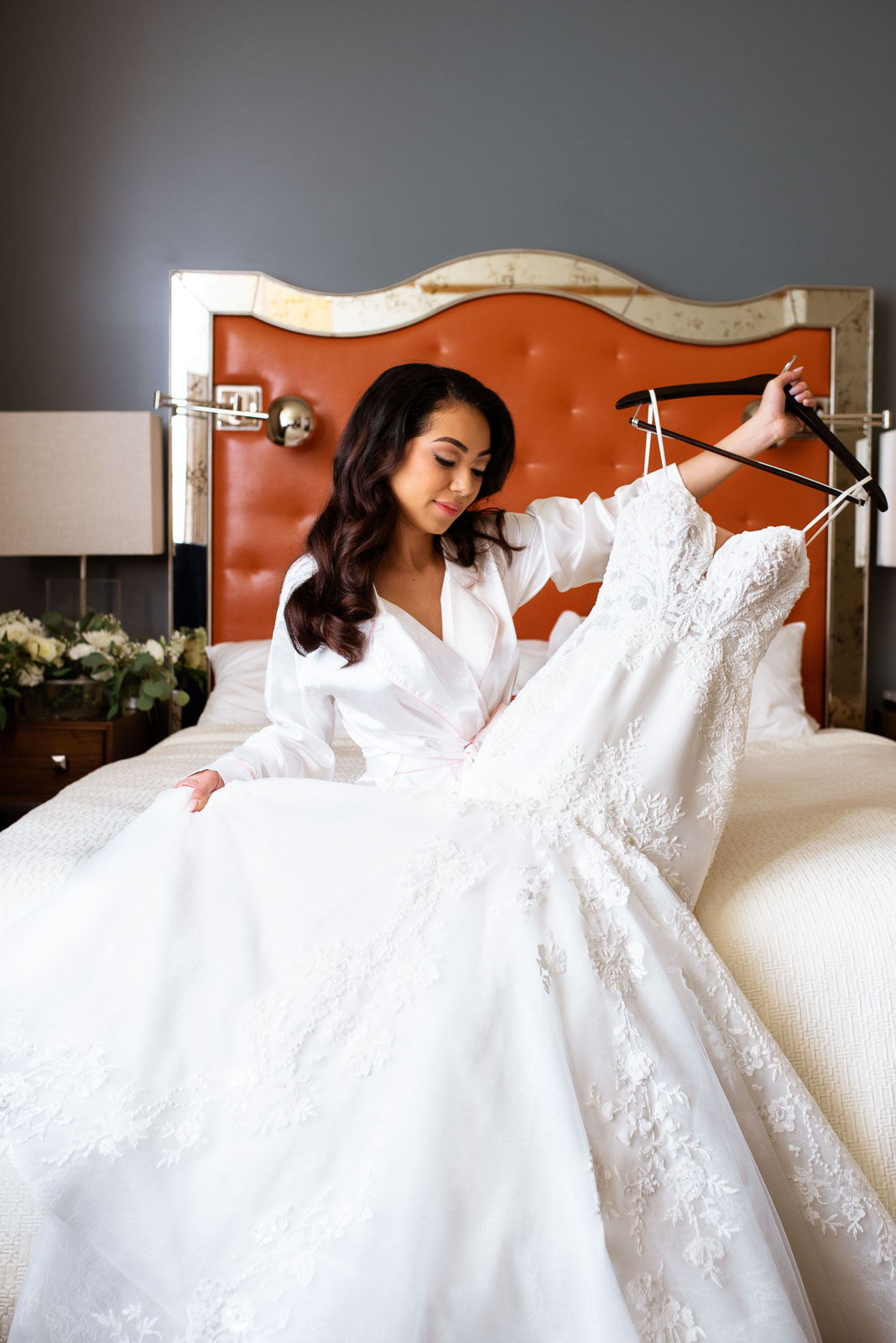 Bride holding her wedding dress, getting ready photos | Josie V Photography