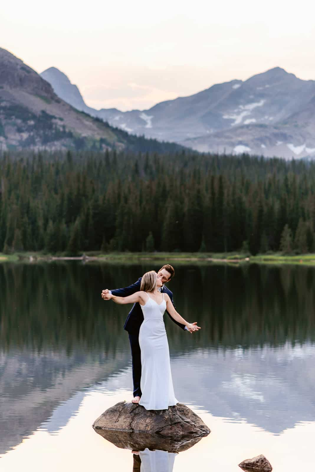 Best Elopement Locations | Josie V Photography, Couple embraces on the water at Brainard Lake near Denver. Brainard Lake is one of the best locations for engagement photos and elopements near Denver.