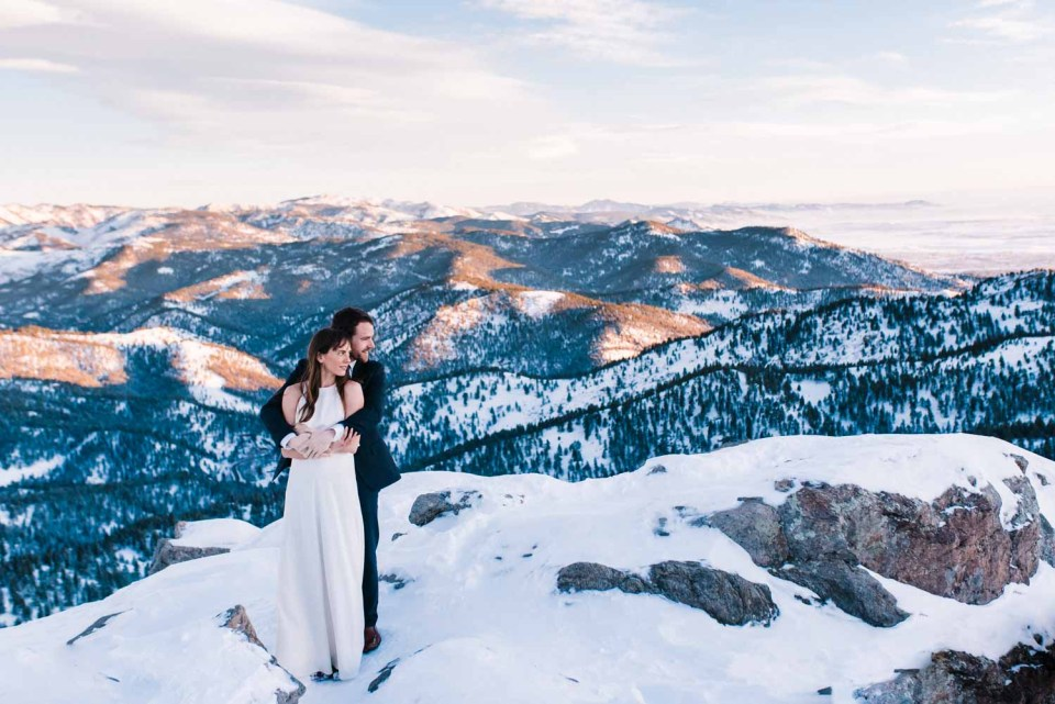 Couple holds one another on top of the Lost Gulch lookout in Boulder, Colorado. Lost Gulch is one of the best photo locations near Denver for it's spectacular views overlooking the valley.